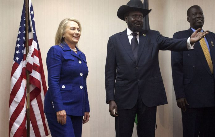 Secretary of State Hillary Rodham Clinton meets with South Sudan President Salva Kiir at the Presidential Office Building in Juba