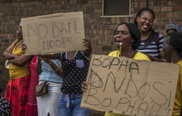 Sideshow: Protesters outside the Umzimkhulu magistrate's court during Mluleki Ndobe's appearance earlier this week.