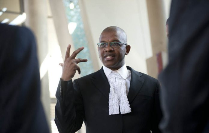Judge Mogoeng Mogoeng announced that the court had dismissed the application for the state to cover the legal costs of the Marikana mineworkers wounded and arrested last year.