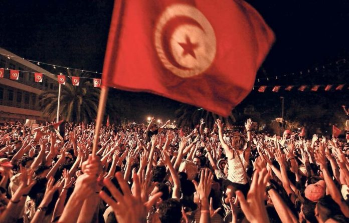 Show of hands: A huge crowd of Tunisians protest in the capital
