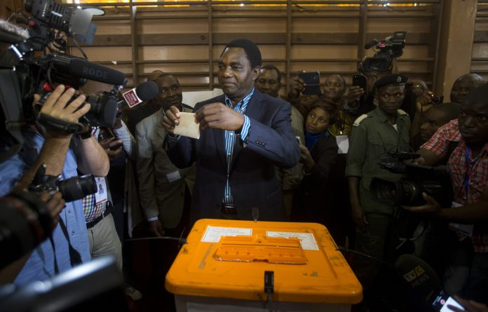 United Party for National Development Presidential candidate Hakainde Hichilema casts his ballot at a voting station in Lusaka