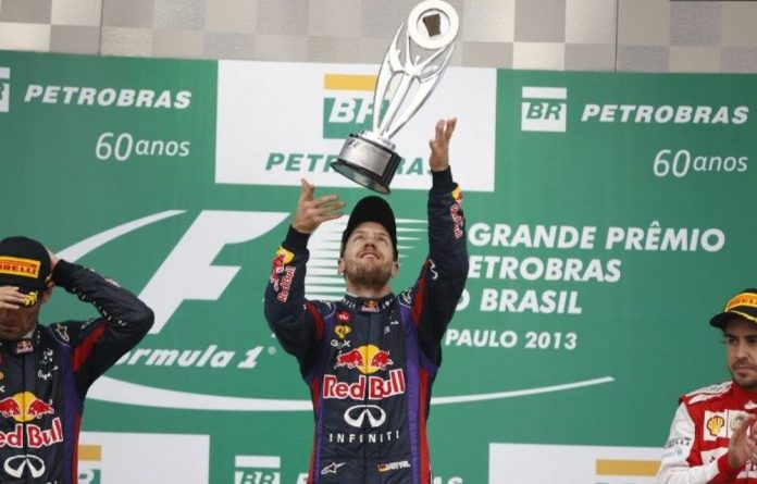 German driver Sebastian Vettel celebrates his victory on the podium of the Brazilian Formula One.