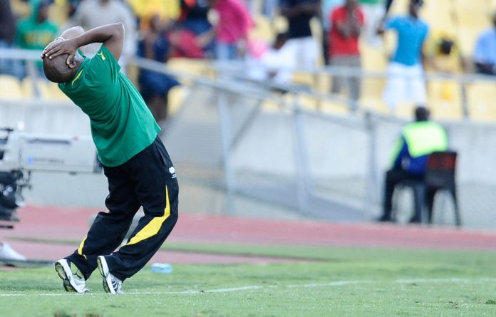 Bafana coach Pitso Mosimane looks dejected during the 2014 Fifa World Cup qualifier match between South Africa and Ethiopia at Royal Bafokeng Stadium.