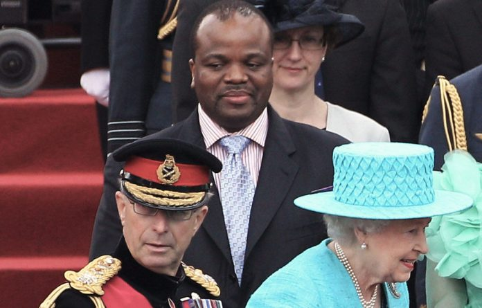 Queen Elizabeth II walks past King Mswati III of Swaziland as she attends the Armed Forces Parade and Muster in Home Park on May 19.