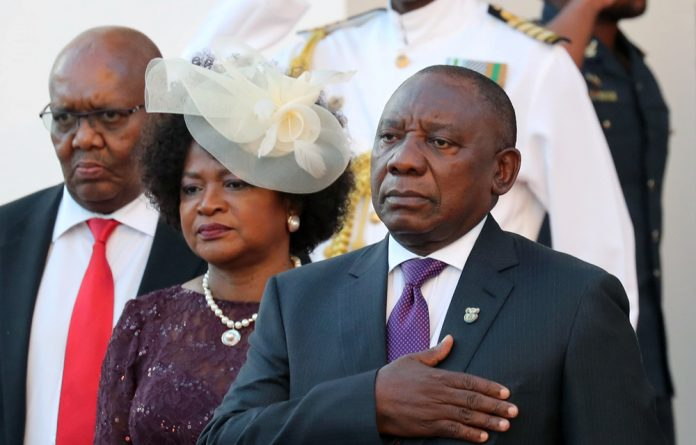 President Cyril Ramaphosa arrives to deliver his State of the Nation address at Parliament in Cape Town.