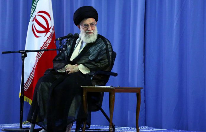 Ayatollah Ali Khamenei attends a meeting with Iranian Prisoners of War from the Iran-Iraq war on August 15 2012 in Tehran.