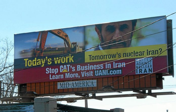 This is the image that put pressure on Caterpillar to pull out of Iran.