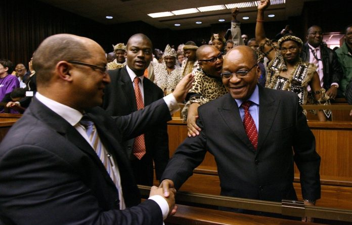 Case closed: Jacob Zuma is ­congratulated by his ­attorney Michael Hulley ­after being found not guilty of rape by Judge Willem van der Merwe in the Johannesburg high court.