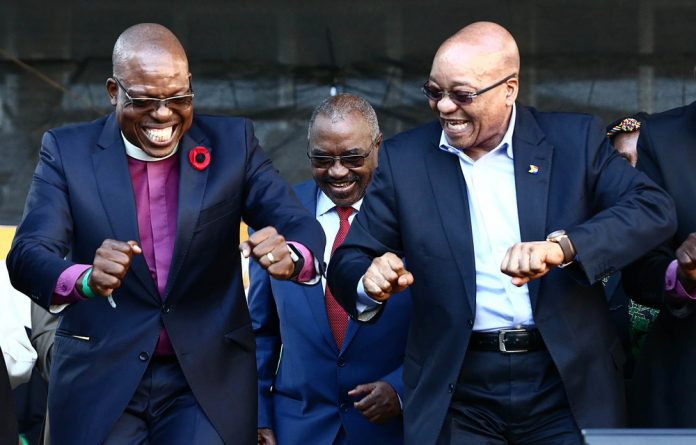 BFFs forever: Former president Jacob Zuma and the Reverend Vusi Dube dance during the National Day of Prayer event two years ago. Dube says he'll still dance for Zuma.