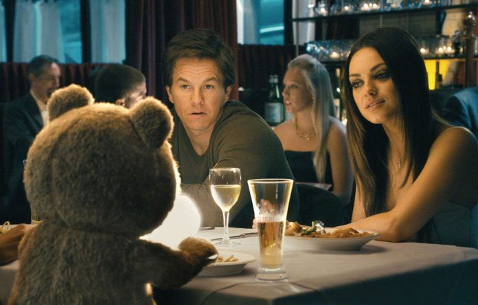 Three for dinner: Mark Wahlberg and Mila Kunis in Ted.