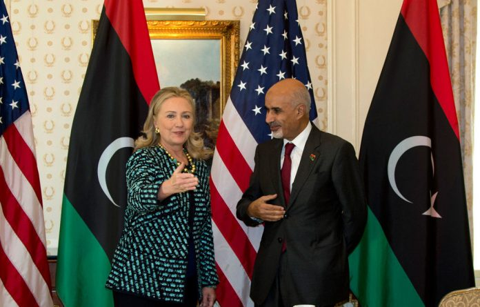 US Secretary of State Hillary Rodham Clinton with Libya's President Mohamed Magariaf.