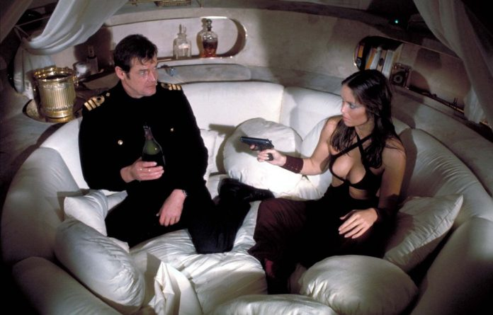 Weapons of choice: Roger Moore and Barbara Bach in The Spy Who Loved Me.