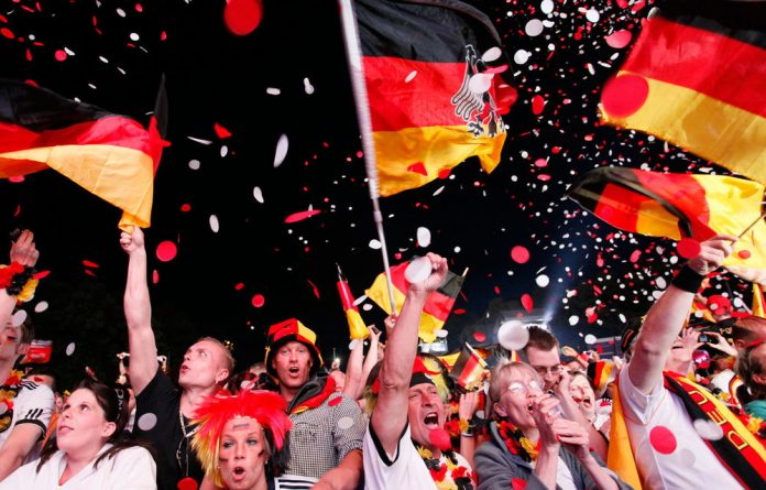 Uefa has charged the German football association after anti-discrimination monitors reported seeing a neo-Nazi banner at a Euro 2012 match.