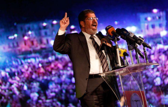 Muslim Brotherhood's presidential candidate Mohammed Mursi speaks at his last rally in Cairo
