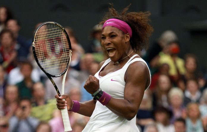 Serena Williams reacts after winning her quarterfinal match against Petra Kvitova on day eight of the Wimbledon Championships.