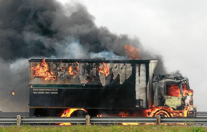 Truck drivers doing their jobs face the risk of violence from striking colleagues.
