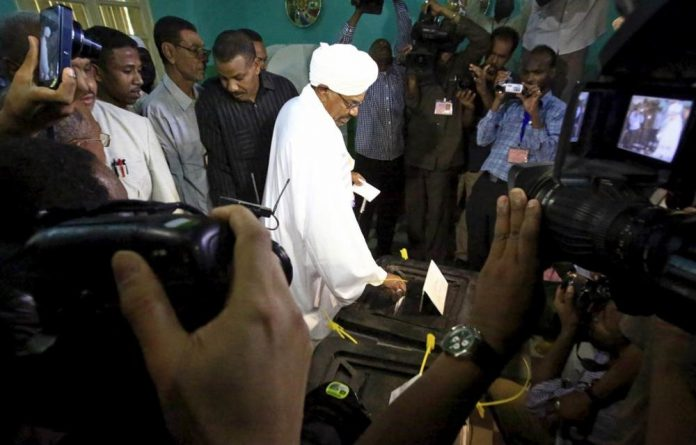Sudan's President Omar Hassan al-Bashir casts his ballot during elections in the capital Khartoum. He is guaranteed to win the poll.