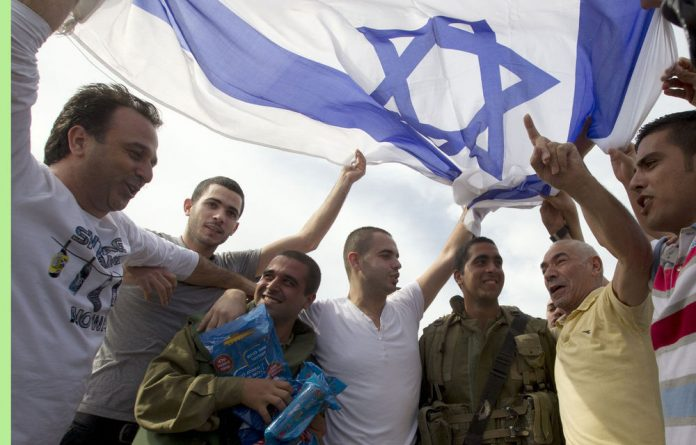 Israelis show support and give gifts to soldiers in the city of Ashdod on Sunday on the fifth day of Israel's bombardment of the Palestinian Gaza Strip.