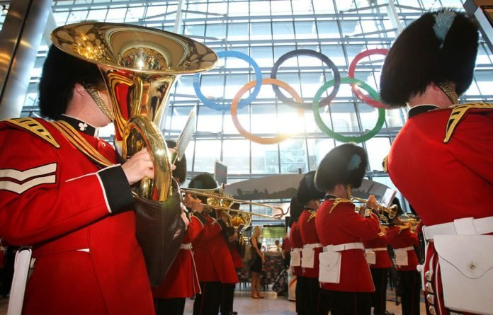 Olympics officials are trying to calm the uproar over a security contractor's failure to provide its promised number of staff.