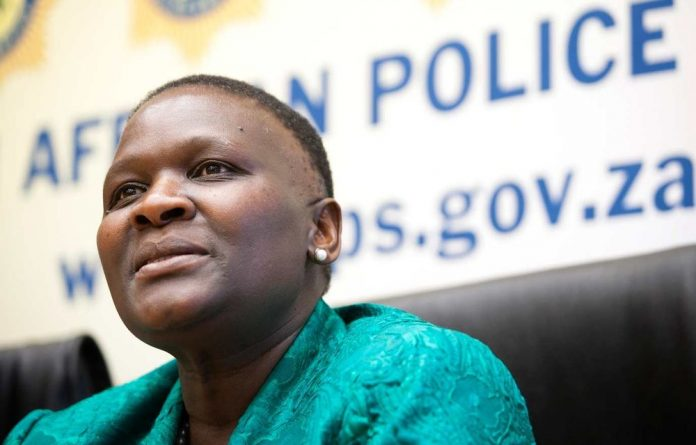 Top cop Riah Phiyega has sparked outrage after being seen laughing and joking during the viewing of a video taken during the Marikana shooting.