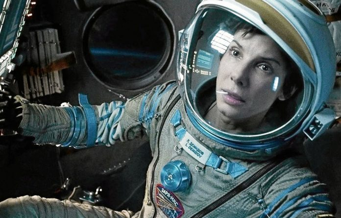 Sandra Bullock as the stranded astronaut in Gravity which is the critics best film of the year.
