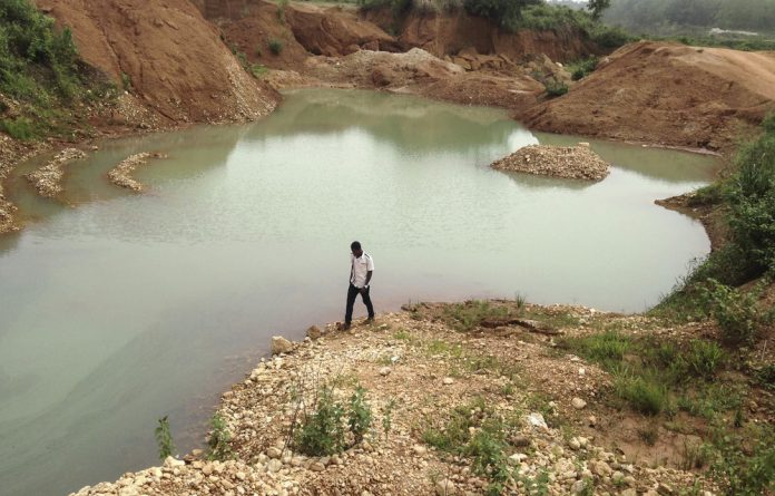 Deadly legacy: Informal gold miners risk their lives while searching for traces of the precious metal in the dangerous 'abandoned death lakes' of eastern Cameroon.