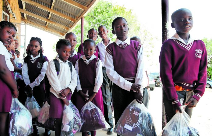 Various organisations work the Gauteng department of social development to provide school backpacks