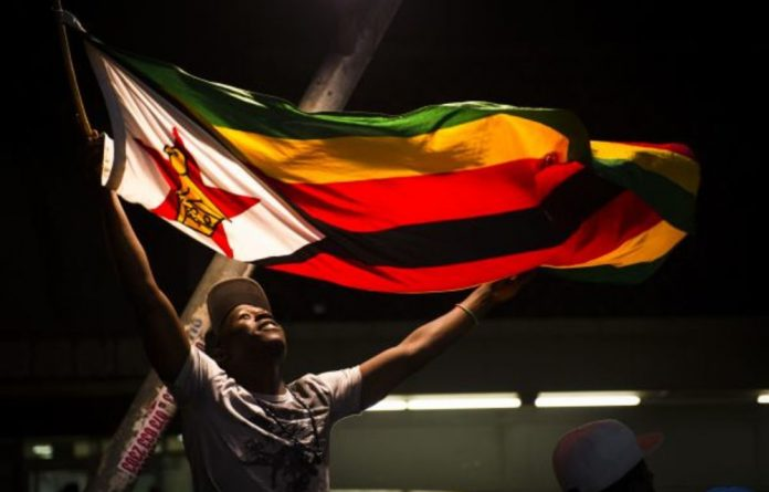 Zimbabweans celebrate a new era for their country in Joburg's streets. South Africans may feel 'coup' envy.
