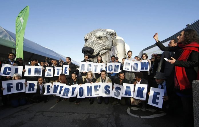 Environmental activists spell out the need for action to save the planet from catastrophe.