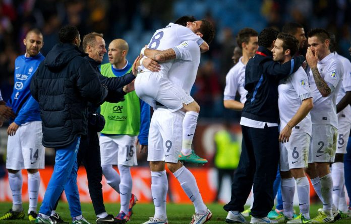Olivier Giroud of France celebrates with Mathieu Valbuena and other teammates at the end of the Fifa 2014 Group I qualifier between Spain and France.