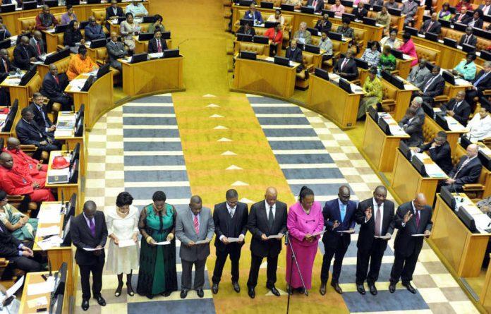 Members of Parliament are sworn in.