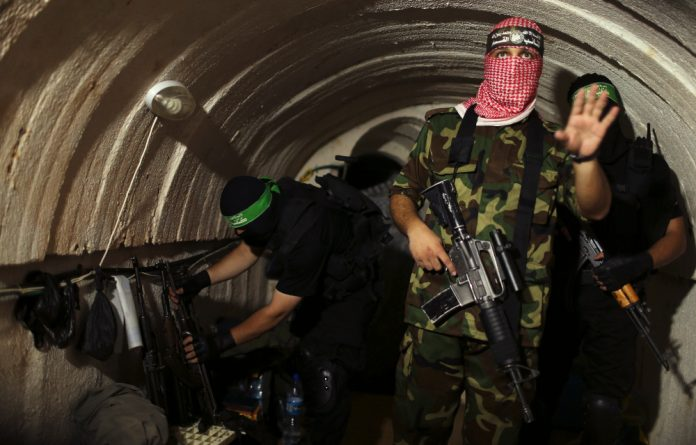 Palestinian fighters from Hamas armed wing Ezzedine al-Qassam Brigades in an underground tunnel in Gaza.