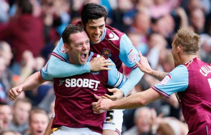 Kevin Nolan of West Ham United celebrates scoring the opening goal with team mate James Tomkins during the Power Championship Playoff semifinal 2nd Leg between West Ham United and Cardiff City at the Boleyn Ground on May 7 in London