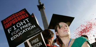 A student protests in Trafalgar Square