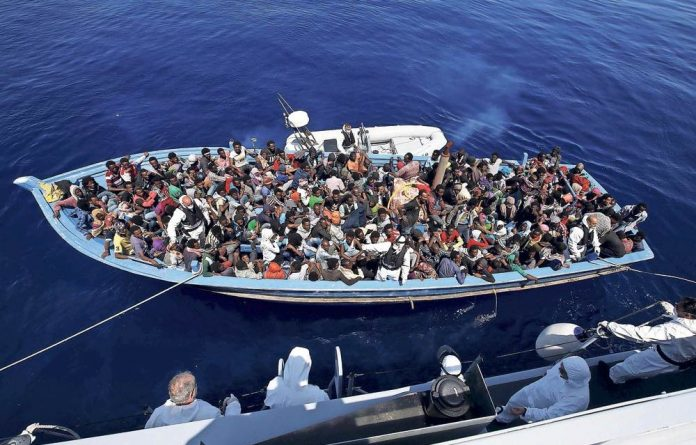 Lucky to be alive: About 300 sub-Saharan Africans are rescued after the boat they were travelling in capsized.