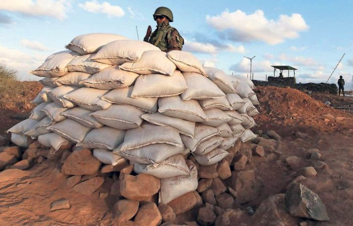 On guard: Rwandan peacekeeping forces are keen to show armed militias they mean business.