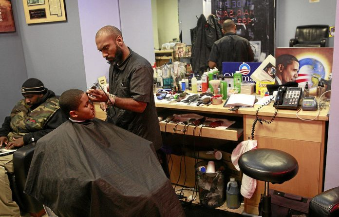 Ishmael Alamin  cuts hair at the Hyde Park Hair Salon in Chicago