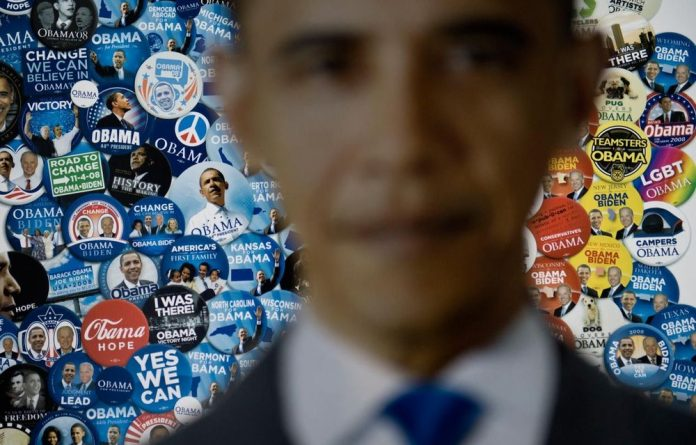 A poster of campaign pins for US President Barack Obama is seen at the American Presidential Experience exhibit in Charlotte