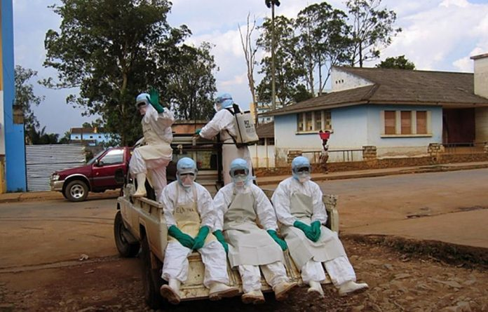 Five health workers dressed in 'Ebola suits' leave Uige