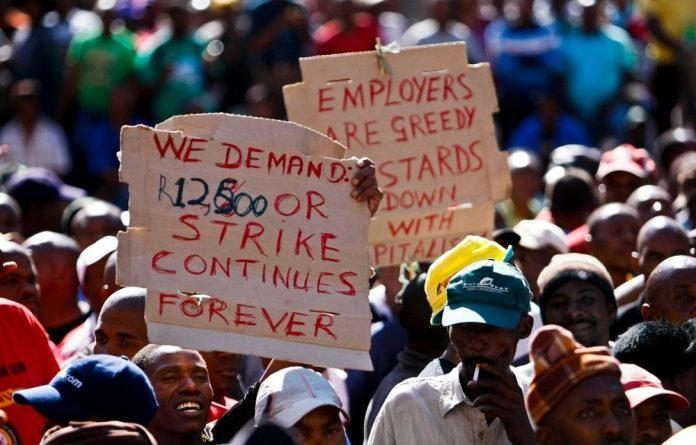 Striking truck drivers belonging to Satawu gather at Beyers Naude Square for a protest march.