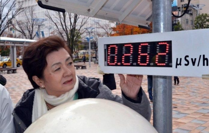 Anti-nuclear Tomorrow Party of Japan leader Yukiko Kada inspecting the radiation levels at a monitoring post in Koriyama