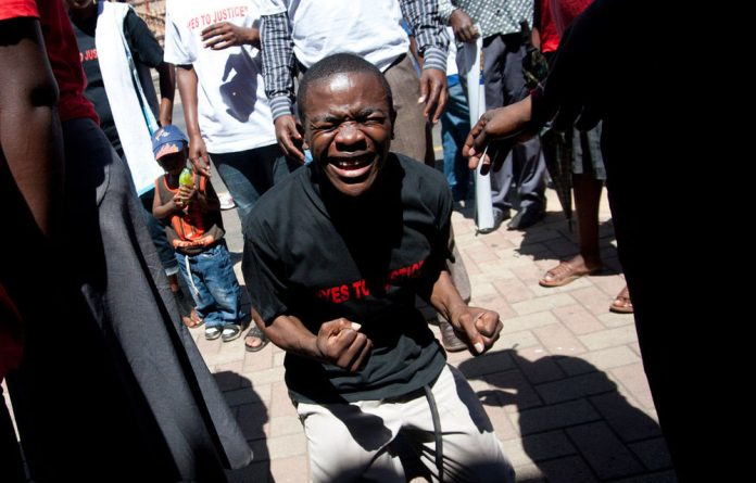 Zimbabwe torture protesters outside the North Gauteng High Court.