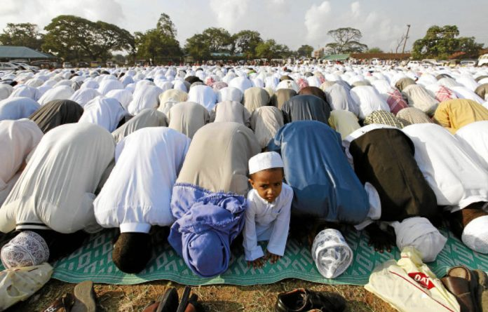 Kenyan Muslims pray during Eid al Fitr in Mombasa. The Kenyan president has said that calls for secession of the coastal region will not be tolerated.