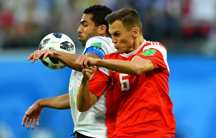 Russia's Denis Cheryshev in action with Egypt's Ahmed Fathy