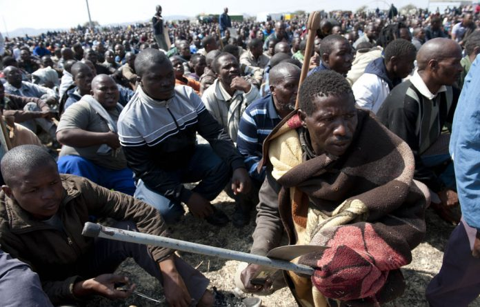 Striking Lonmin workers have vowed to stay away from work until their demand for a R12 500 monthly wage is met.