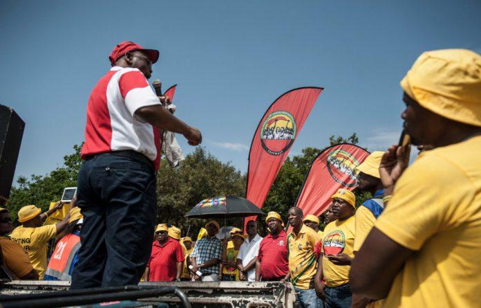 Cosatu president Sdumo Dlamini addresses Ceppwawu members and those of other Cosatu unions at a protest march in Bryanston