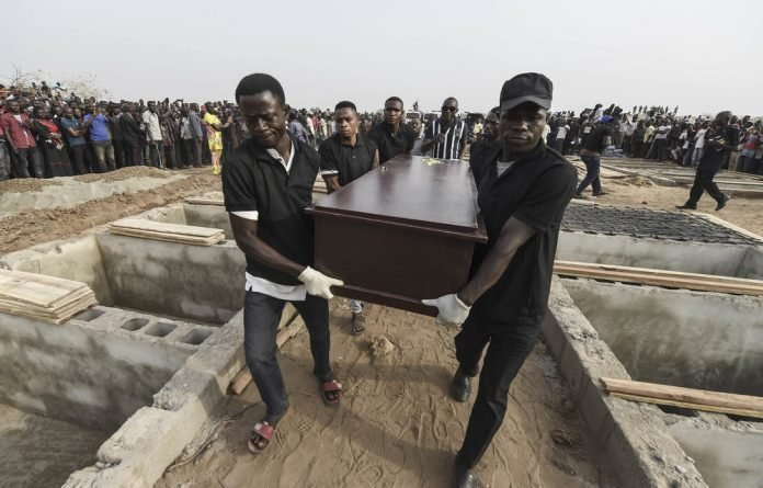 Victims: Pall bearers carry coffins during a funeral service in Makurdi