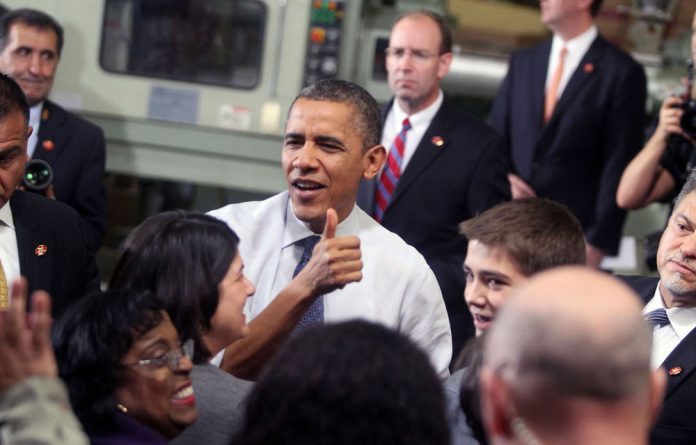 US President Barack Obama gives the thumbs up at The Rodon Group manufacturing facility in Hatfield
