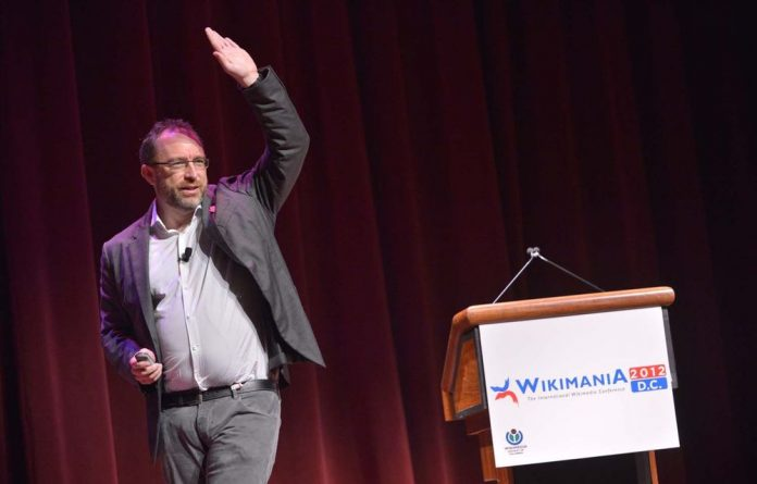 Wikipedia founder Jimmy Wales speaks during