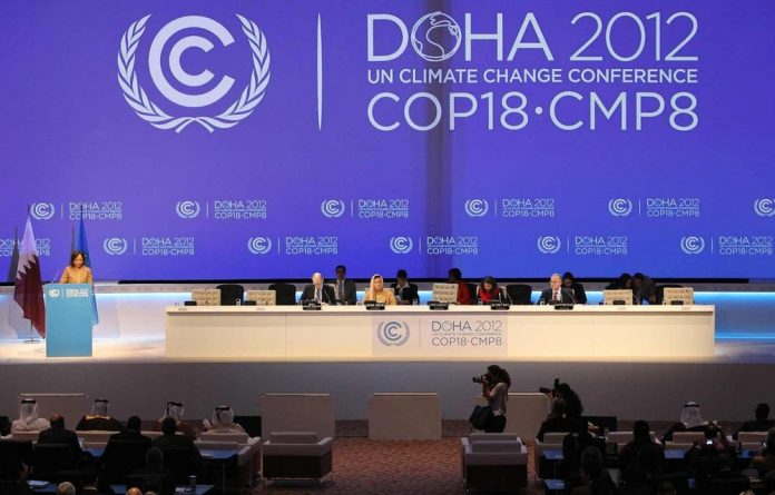Negotiators in Doha must extend the greenhouse gas-curbing Kyoto Protocol as an interim measure to rein in climate change.